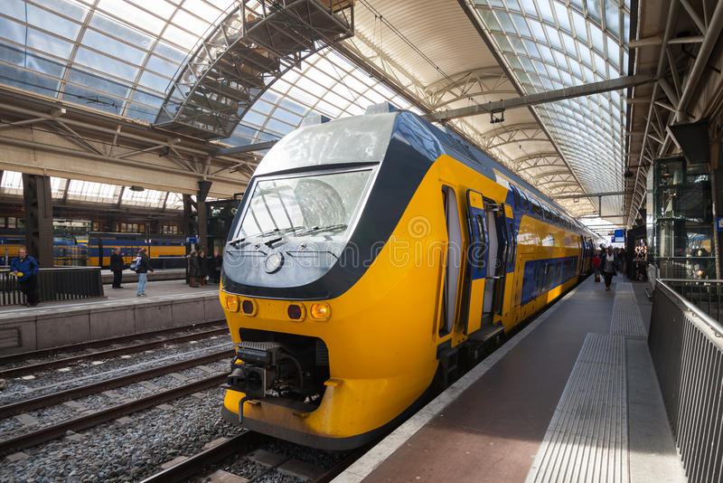 yellow-train-stands-central-railroad-station-amsterdam-netherlands-march-40496888.jpg