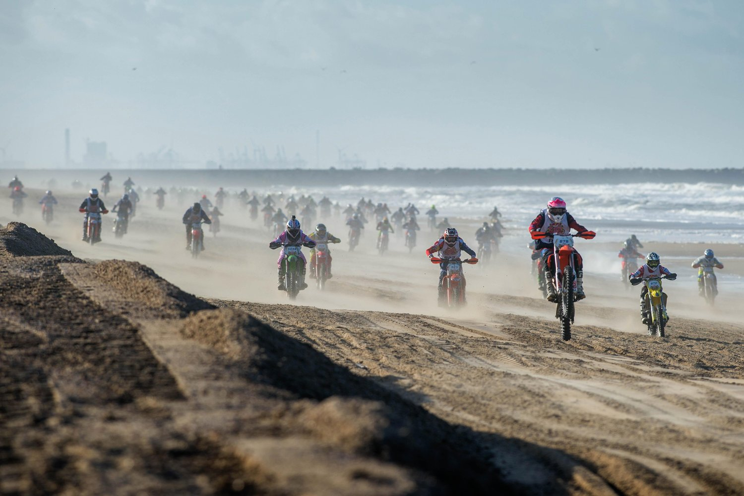 riders-charge-at-the-start-of-the-red-bull-knock-out-beach-race-in-the-hague-netherlands.jpg